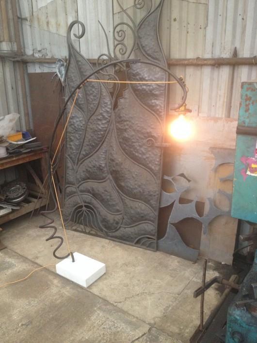 Designer light <u>up-cycle</u>d from a car spring